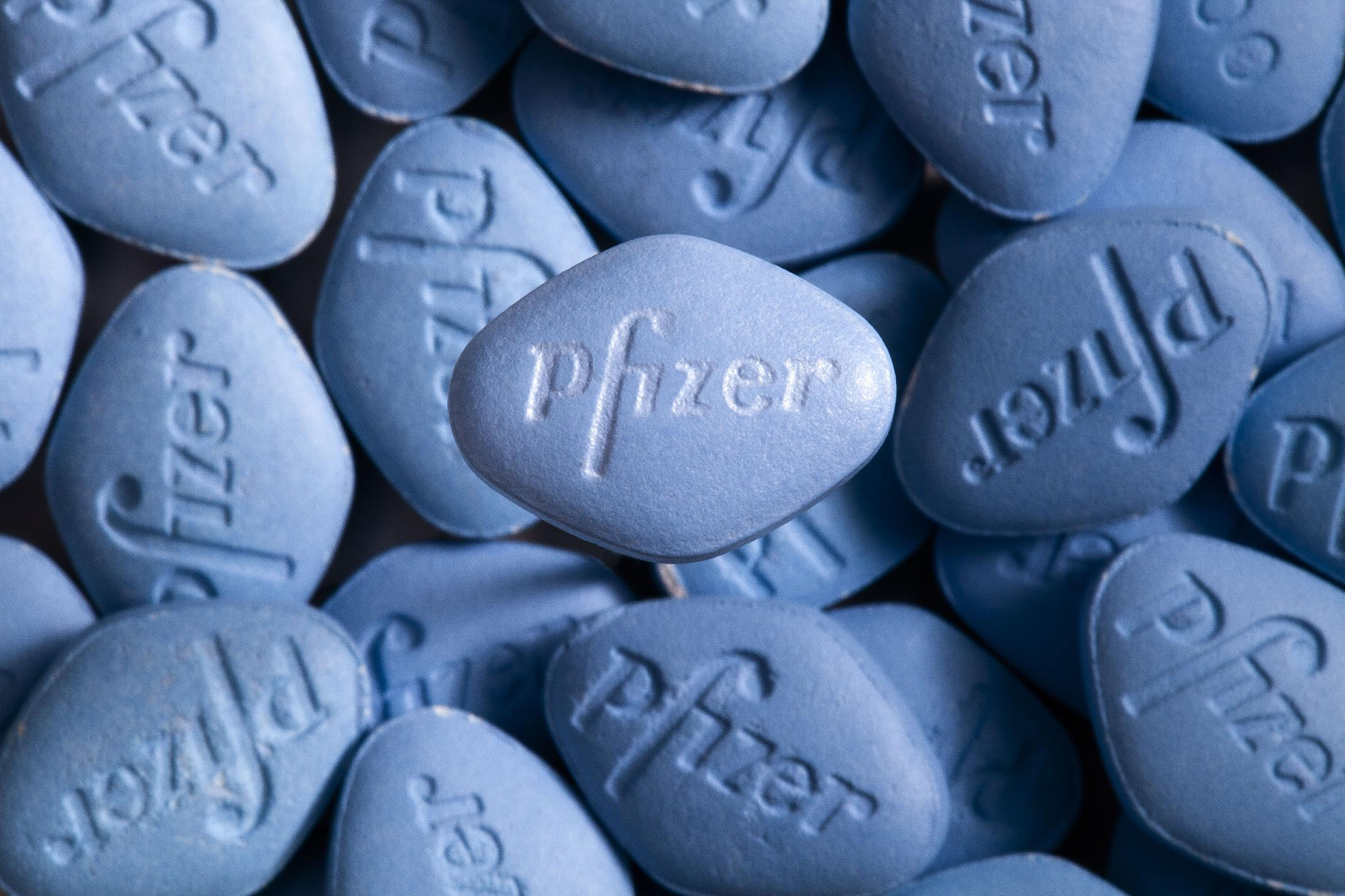 This undated photo provided by pfizer shows a real Viagra pill on top of counterfeit pills. In a first for the drug industry, Pfizer Inc. told The Associated Press on May 6, 2013, that it will sell erectile dysfunction pill Viagra directly to patients on its website. (AP Photo/pfizer, William Vazquez)