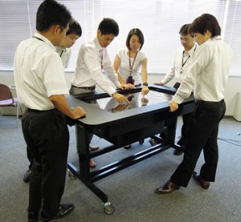 NEC 52-inch table disguised as boring office furniture