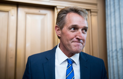 Sen. Jeff Flake, R-Ariz., speaks with reporters after a vote in the Capitol on July 20, 2017. (Photo: Bill Clark/CQ Roll Call/Getty Images)