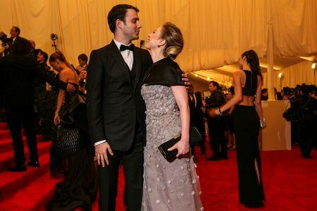 """Chelsea Clinton arrives with husband Marc Mezvinsky at the Metropolitan Museum of Art Costume Institute Benefit celebrating the opening of """"PUNK: Chaos to Couture"""" in New York"""