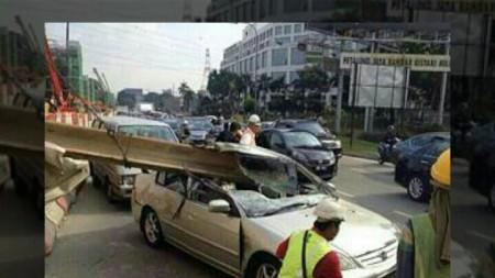 NARROW ESCAPE : TWO INJURED AFTER METAL BEAM FALLS ON CAR