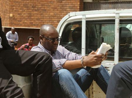 Zimbabwean pastor Evan Mawarire reads a bible as he arrives at the Harare Magistrates court in Harare, Zimbabwe, February 3, 2017.REUTERS/Philimon Bulawayo