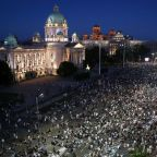 Serbian protesters defy ban and unite in streets after two nights of violence