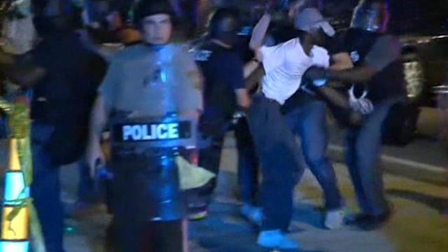 More clashes in Ferguson ahead of U.S. Attorney General's visit
