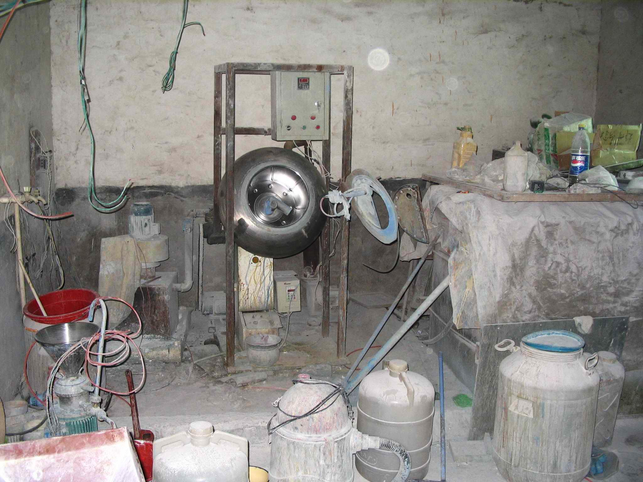 """This September 2005 photo provided by Pfizer shows an illegal pharmaceutical """"factory"""" in Henan Province, China, during a raid where authorities seized 10 lines of manufacturing equipment and counterfeit medicines valued at $4.3 million (USD), including about 440,000 counterfeit Viagra doses. In a first for the drug industry, Pfizer Inc. told The Associated Press on May 6, 2013, that it will sell erectile dysfunction pill Viagra directly to patients on its website. (AP Photo/Pfizer)"""