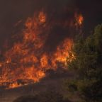 Fire sweeps through Southern California canyon, residents flee