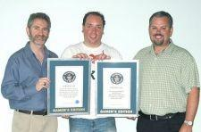 Mike Morhaime and Paul Sams accept Guinness World Record awards