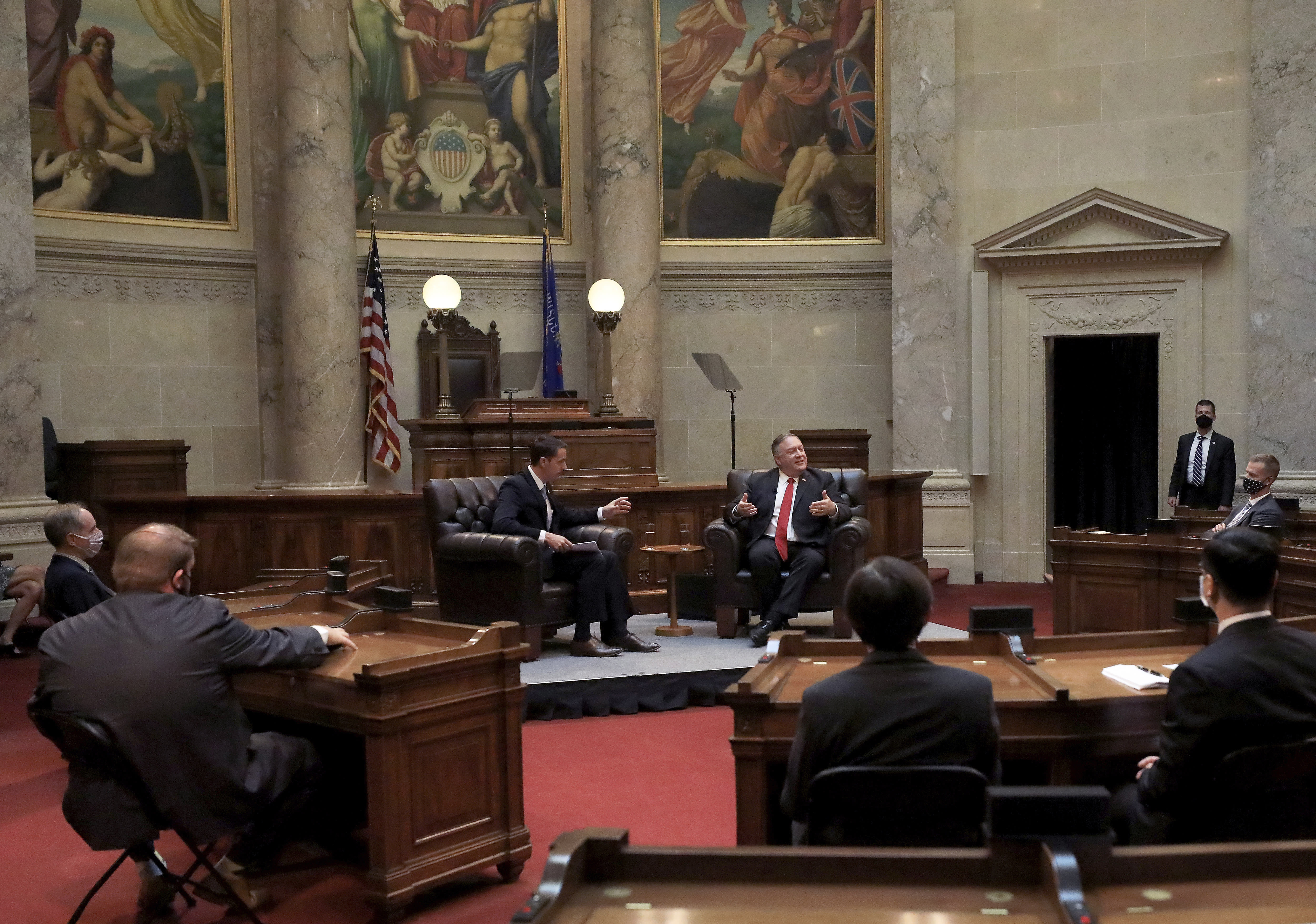 Secretary of State Mike Pompeo , right, responds to a question from Wisconsin Senate President Roger Roth, R-Appleton, during a question and answer sessions with state Republican legislators in the Senate chamber of the Wisconsin State Capitol in Madison, Wis. Wednesday, Sept. 23, 2020. (John Hart/Wisconsin State Journal via AP)