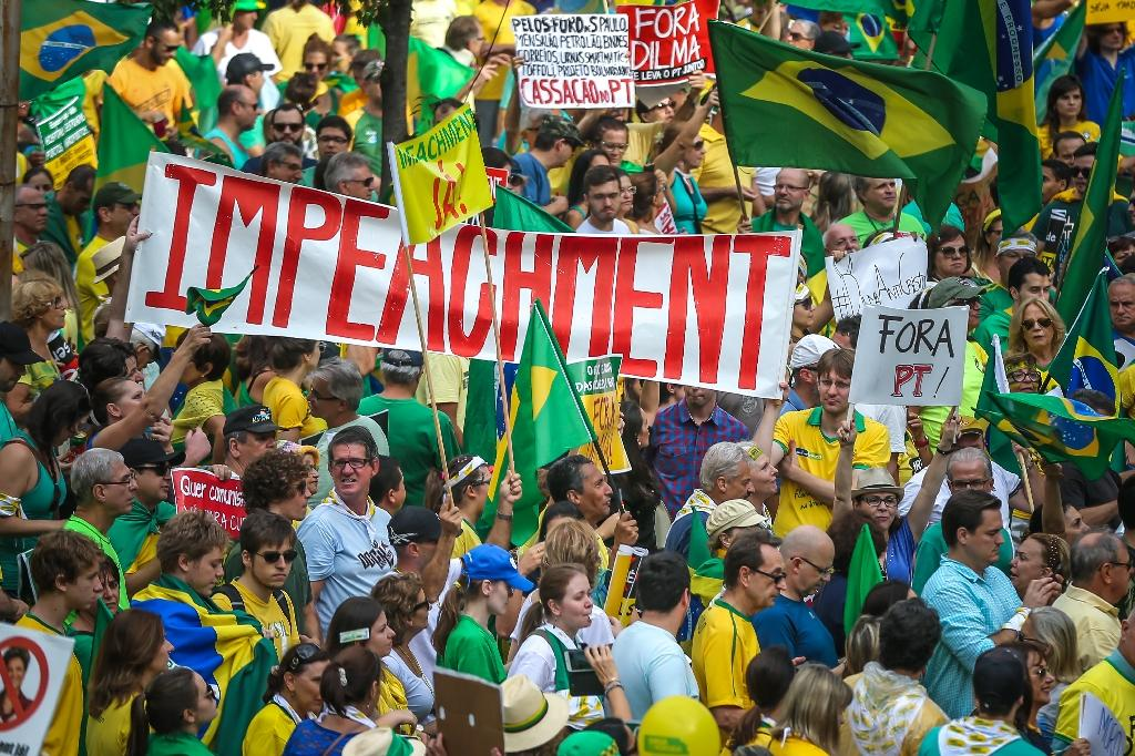 Demonstrators take part in a protest against the government of President Dilma Rousseff in Porto Alegre, Brazil on April 12, 2015 (AFP Photo/Jefferson Bernardes)