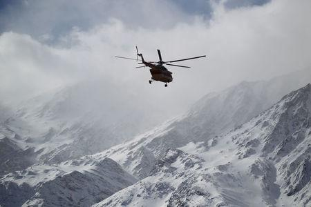 Emergency and rescue helicopter searches for the plane that crashed in a mountainous area of central Iran, February 19, 2018. REUTERS/Tasnim News Agency