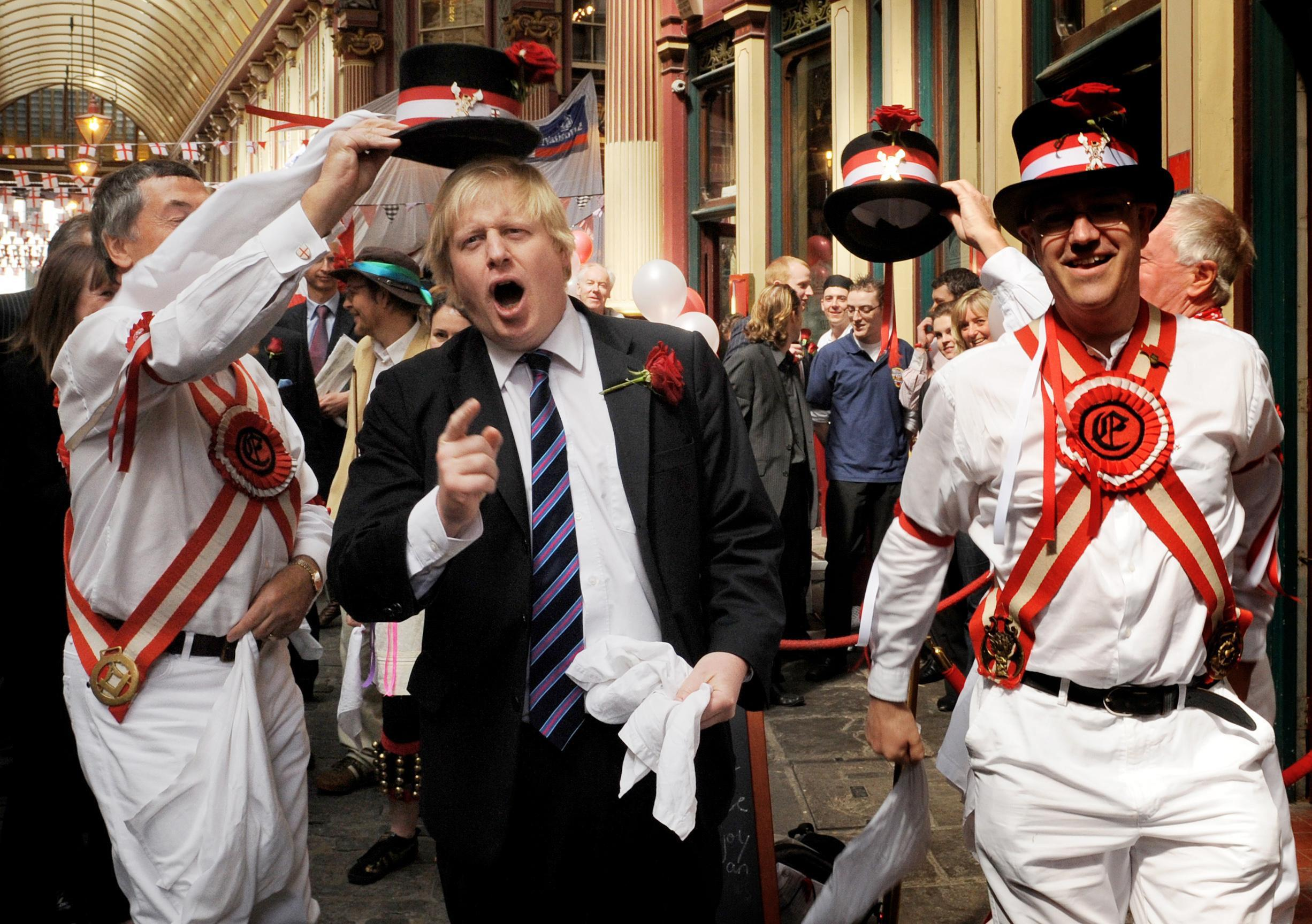 London Mayor Boris Johnson (2nd Left) celebrates St Georges Day in Leadenhall Market in the City of London today where he saw a festival of English food and drink.