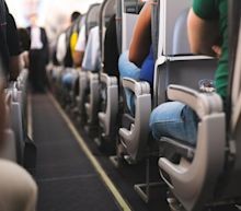 Woman in 30s who died on commercial flight had coronavirus, officials rule