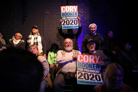 Supports hold signs in support of U.S. Senator Cory Booker (D-NJ) as he speaks during his 2020 U.S. presidential campaign in Des Moines, Iowa, U.S., February 9, 2019. REUTERS/Scott Morgan