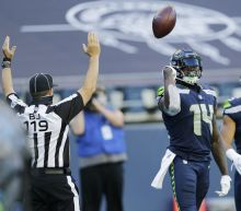 Wilson throws 5 more TD passes, Seahawks beat Cowboys 38-31