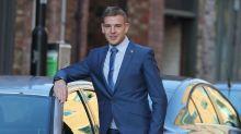 'Giant' car dealer seen driving convertible with head above windscreen avoids jail
