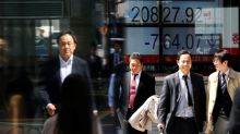 Asian shares rise on U.S. earnings but trade worries rattle yuan