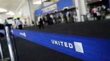 United cuts overbooking, hikes compensation after passenger fiasco