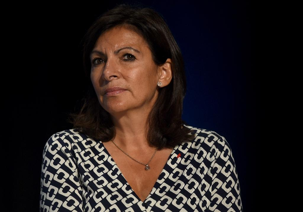 Mayor of Paris Anne Hidalgo denounced the attack on gay rights activist Guillaume Melanie and invited him to help with the city's action plan against homophobic violence (AFP Photo/ERIC PIERMONT)