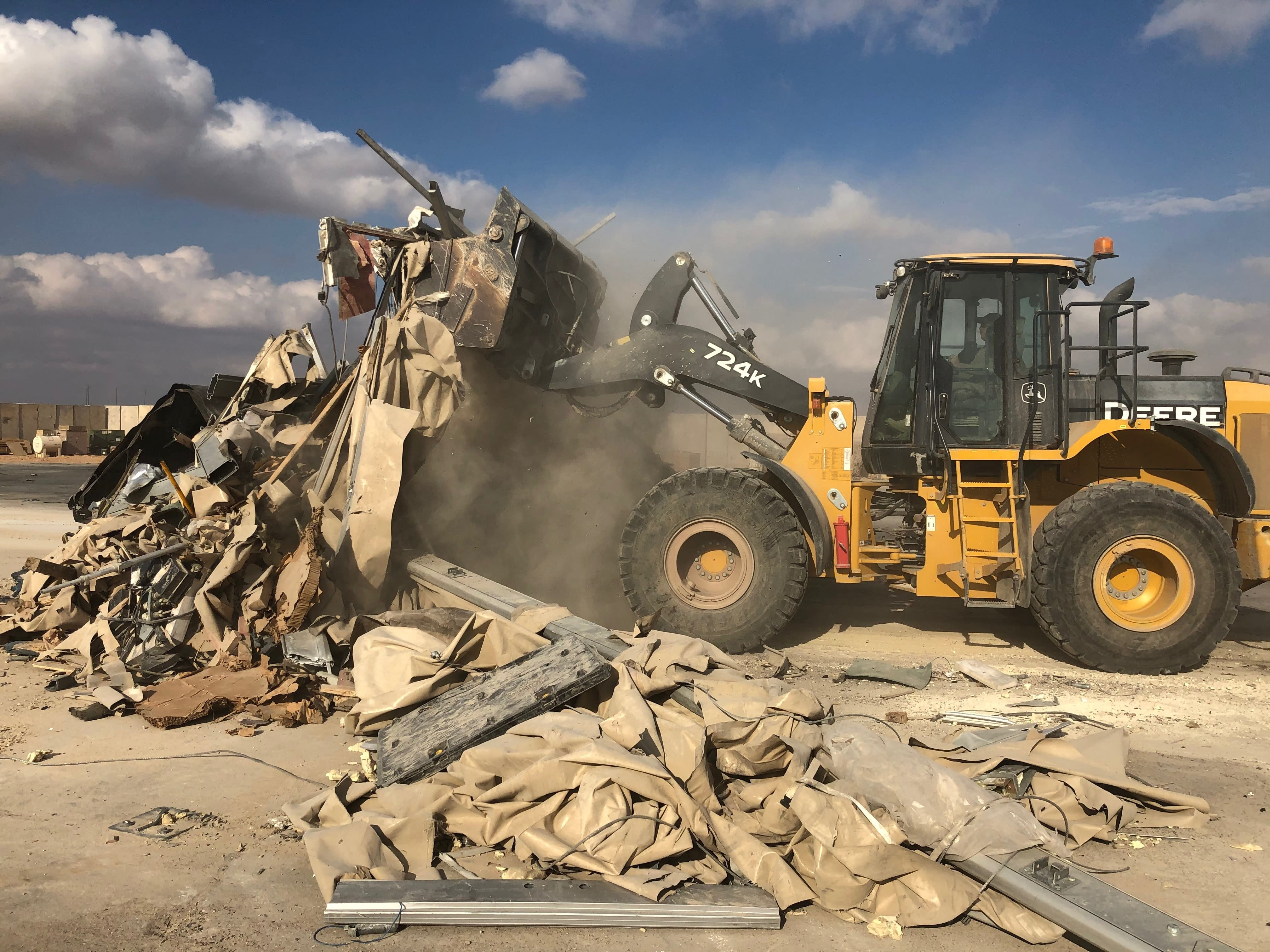 A bulldozer clears rubble and debris at Ain al-Asad air base in Anbar, Iraq, Monday, Jan. 13, 2020. Ain al-Asad air base was struck by a barrage of Iranian missiles in retaliation for the U.S. drone strike that killed atop Iranian commander, Gen. Qassem Soleimani, whose killing raised fears of a wider war in the Middle East. (AP Photo/Qassim Abdul-Zahra)