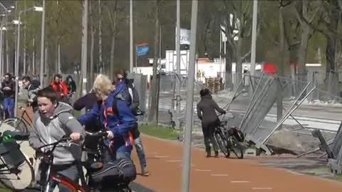 Strong Wind Blows Away Bikers