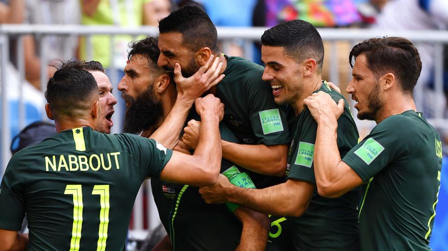 Socceroos' World Cup hopes alive after Denmark draw