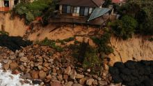 Storm lashes Australian coast threatening homes
