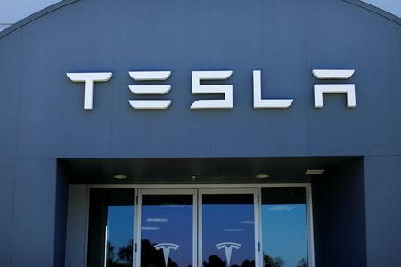 A Tesla sales and service center is shown in Costa Mesa, California