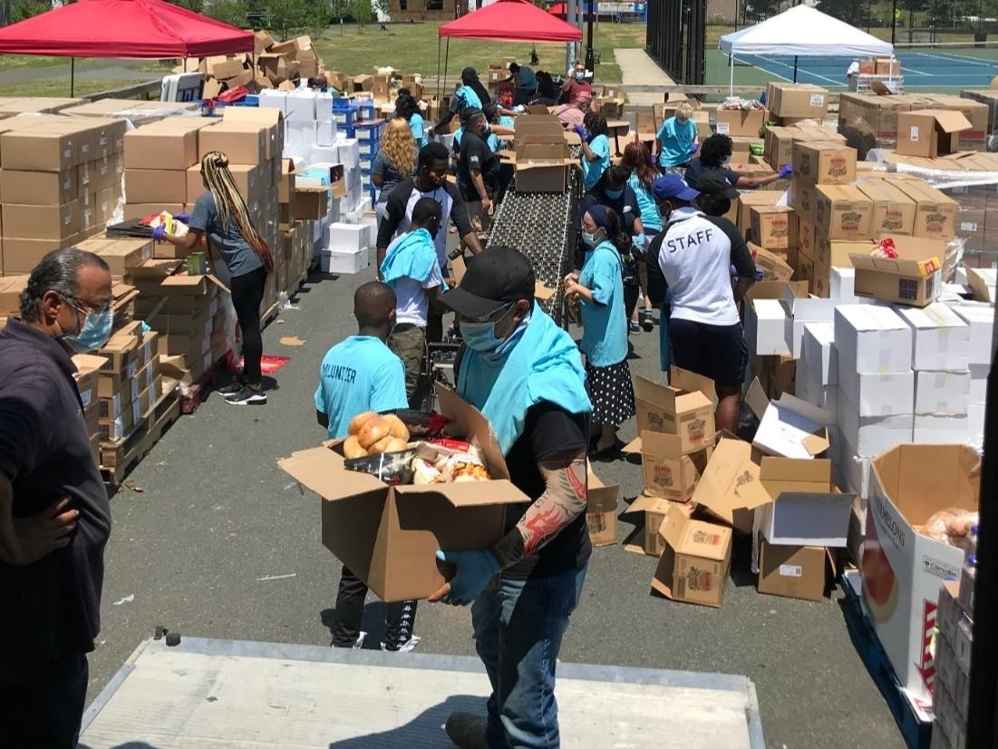 A previous food giveaway event hosted by the United Community Corporation, Roosevelt Community 4U and Bessie Green Community.