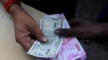 Asian currencies advance; rupee surges on India tax cuts