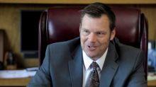 Kansas judge strikes down voter ID law