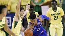 Kansas edges Baylor to close in on record-tying 13th straight Big 12 title