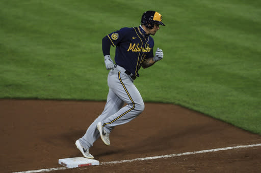 Milwaukee Brewers' Jace Peterson runs the bases after hitting a two-run home run in the ninth inning during a baseball game against the Cincinnati Reds in Cincinnati, Monday, Sept. 21, 2020. (AP Photo/Aaron Doster)