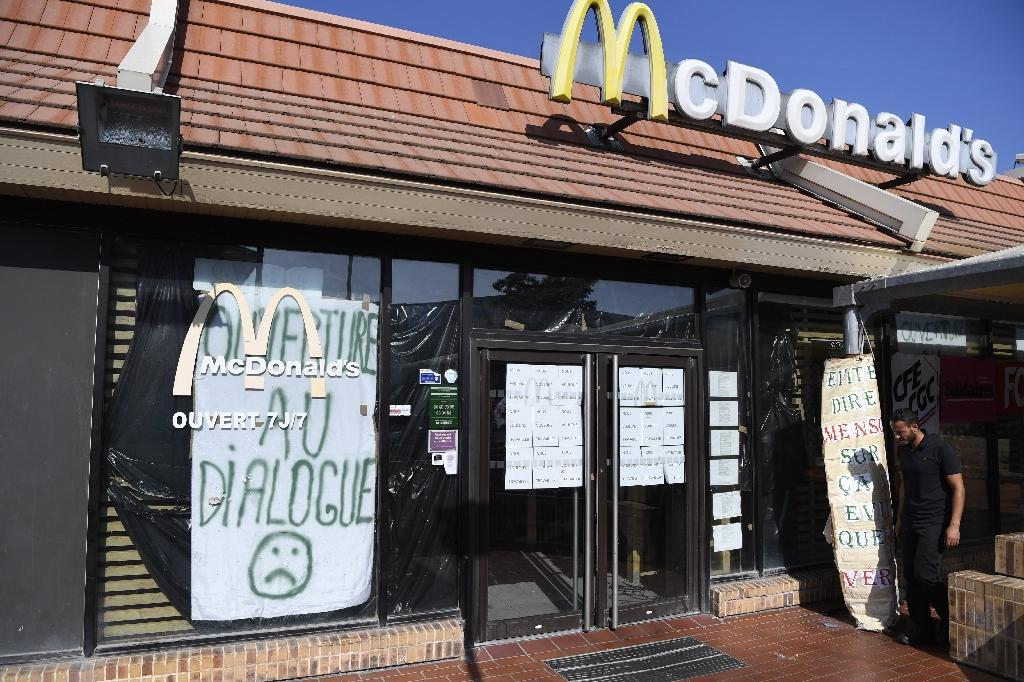 Employees at a McDonald's in a poverty-blighted neighbourhood of Marseille, southern France, said closing the site would deprive residents of a key provider of social cohesion