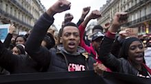 Protesters march in Paris against police violence