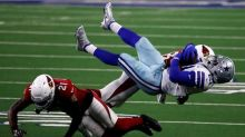 Elliott fumbles pair, Cowboys stumble in 38-10 loss to Cards