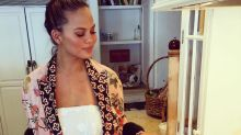 Chrissy Teigen just cooked using a hot sauce branded with her own face and it's totally #goals, TBH