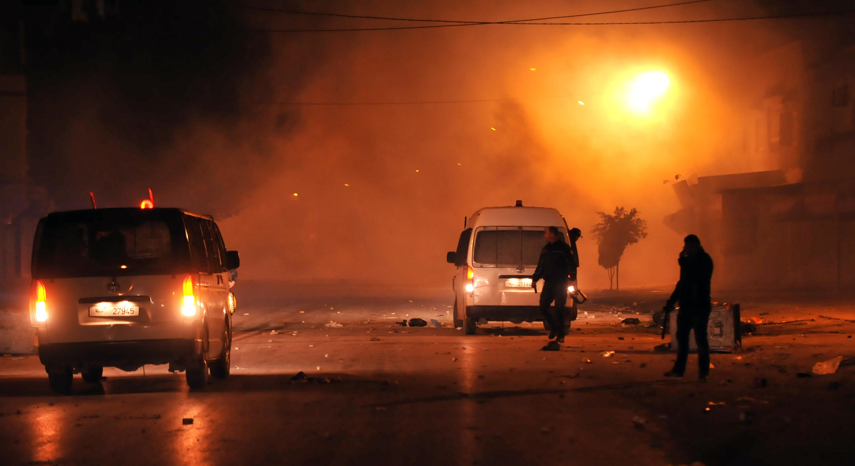 <p>Tunisian police track down rioters in Tunis' Djebel Lahmer district early on Jan. 10, 2018 after price hikes ignited protests in the North African country. (Photo: Sofiene Hamdaoui/AFP/Getty Images) </p>