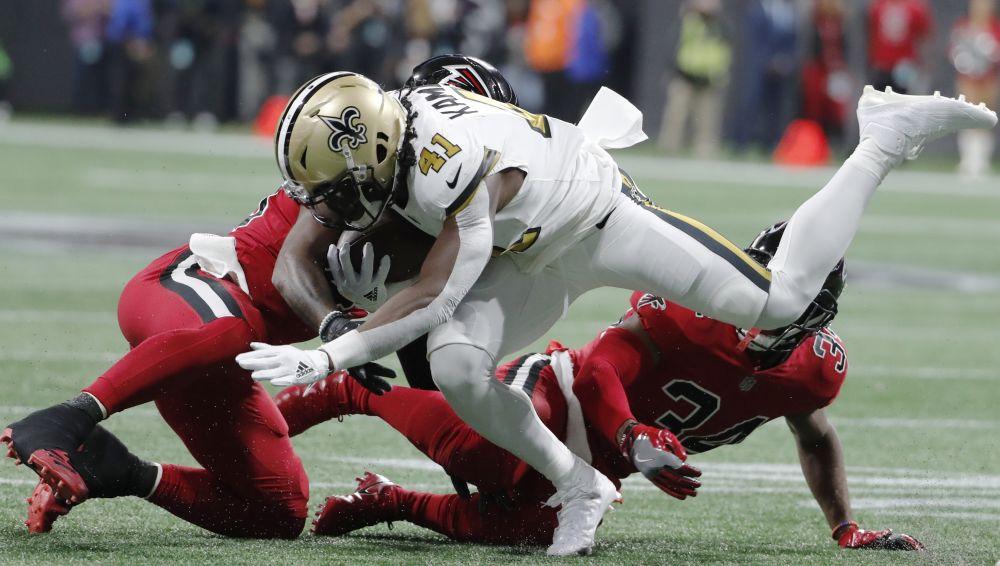 Atlanta Falcons middle linebacker Deion Jones (45) hits New Orleans Saints running back Alvin Kamara (41) on Thursday night. (AP)