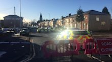 Three children killed in Greater Manchester house fire as police launch murder probe