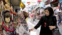 Some Iranian women take off hijabs as hard-liners push back