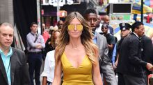 Heidi Klum Turns Heads in Curve-Hugging Gold Dress