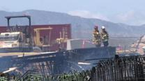 Crews Rush to Remove Remnants of Burned Bridge