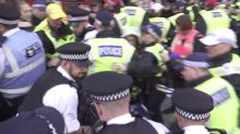 Clashes, arrests and Nazi salutes as Tommy Robinson supporters clash violently with anti-fascists in London