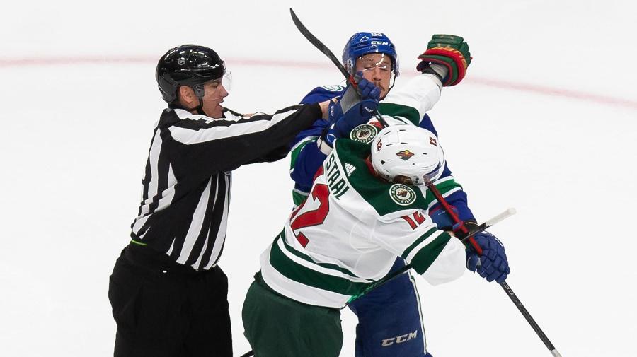 Fan-free playoff hockey still brings intensity
