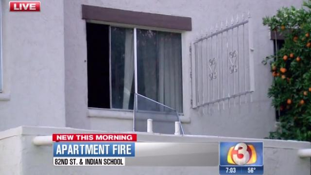 Woman climbs out second-story window to escape fire; neighbors help