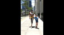 'King of the Catwalk' Sinon Loresca struts with viral 'sugar walk' boy