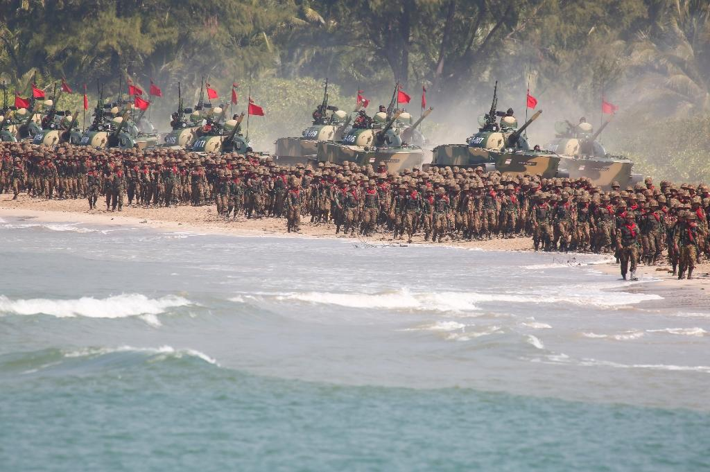 Myanmar troops and tanks move in formation along the shore during the second day of the 'Sin Phyu Shin' joint military exercises in Ayeyarwaddy delta region in 2018 (AFP Photo/LYNN Bo Bo)