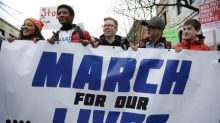 'Vote them out!': Thousands register to vote at U.S. gun-control marches