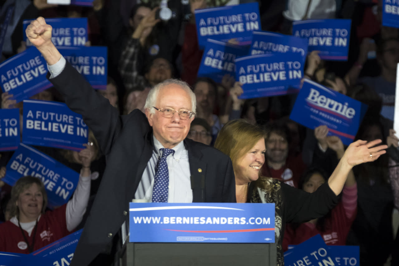 <p>Democratic presidential candidate, Sen. Bernie Sanders, I-Vt., and his wife, Jane, acknowledge the crowd as he arrives for his caucus-night rally in Des Moines, Iowa, on Monday, Feb. 1, 2016. <i>(Photo: Patrick Semansky/AP)</i></p>
