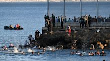 Troops deployed as low tide sees 5,000 migrants wade from Morocco to Spanish enclave